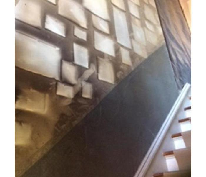 Soot damaged stairway from residential fire