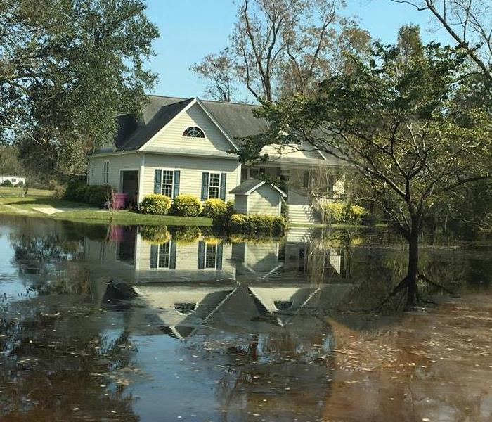 Flood water surrounding a Home